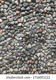 Gray small stone mosaic wall background for decorative ornament