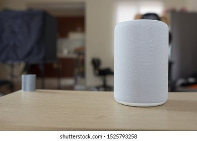 Gray smart speaker with cloth texture. Shallow depth of field with bokeh effect. Enough space for caption.
