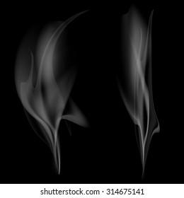 Gray smoke isolated on black background. Stock image.