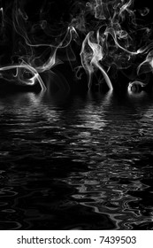 Gray smoke on water with reflection in rippled water