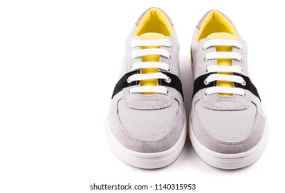 gray sneakers on a white background, isolated