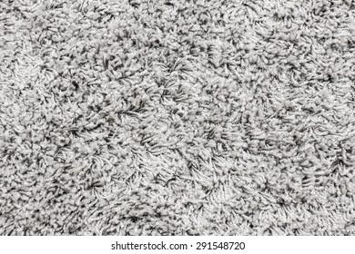 Gray soft plush carpet fiber texture.