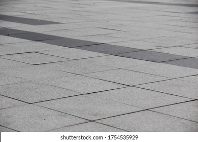 Gray square tiles on the street. Backgrounds
