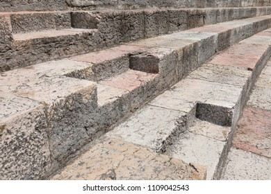 Gray stair steps made of stone. Ancient Roman stone stairs in Verona, Italy.