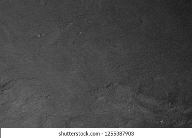 Gray stone texture closeup. Graphite gray