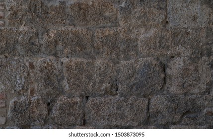 Gray stone wall. Texture of a stone wall. Old castle stone wall texture background. Background or texture. Part of a stone wall, for background or texture.