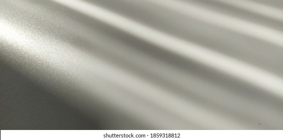 Gray striped background with oblique light effect. Play of light and shadow. Light rays. Gray and silver shades with white dots and shining stars. Diagonal lines from left to right
