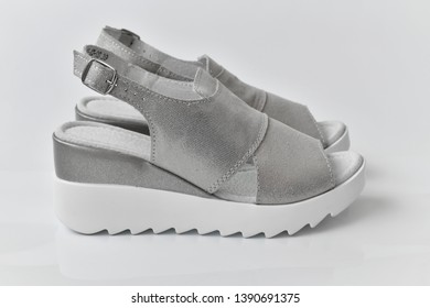 Gray summer female sandals on a white background