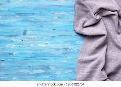 Gray tablecloth from right side of blue wooden table top view with copy space