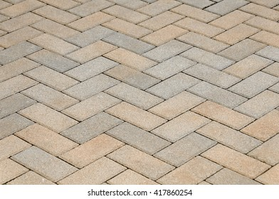 Gray and tan bricks in a lattice looking background.