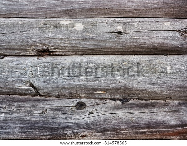 the gray texture of the wooden wall. The old wood. Photo.