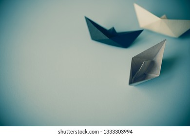 gray tone paper boat on clean background with copy space, journey and obstacle concept