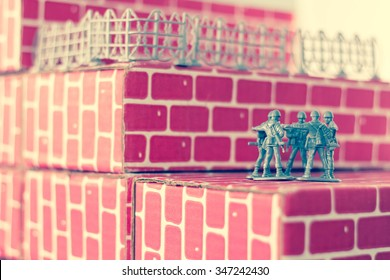 Gray toy army men up against impossible odds in uphill battle