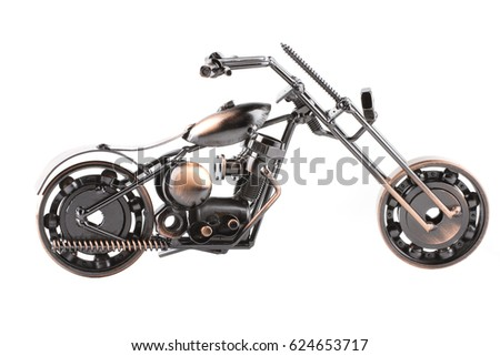 Gray toy metal motorcycle on white background