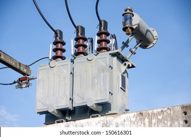 gray transformer on substations with blue sky