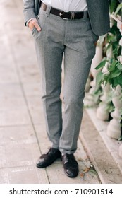 gray trousers on the man