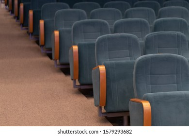 Gray velvet seats for spectators in the theater or cinema
