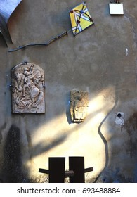 gray wall with artistic sculptures