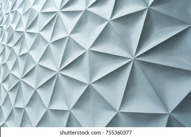 Gray wall with geometric pattern abstrack.