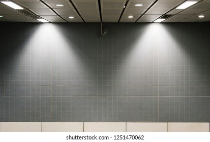 Gray wall mockup inside of a train station