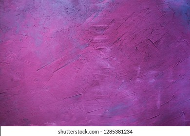 Gray wall painted in pink, mauve and purple. Visible plaster texture. Abstract background