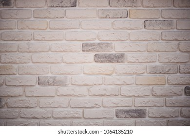 Gray and white brick wall background. Texture of painted brick.