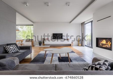 Prime Gray White Family Living Room Fireplace Stockfoto Jetzt Download Free Architecture Designs Sospemadebymaigaardcom