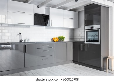 Gray and white kitchen with modern brick wall
