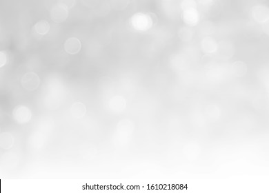 Gray and white nature blurred color glow colorful light sparkling summer. Valentine's day blurry concept. Abstract white bokeh texture with soft foreground bubble shiny in grey vintage style bright.