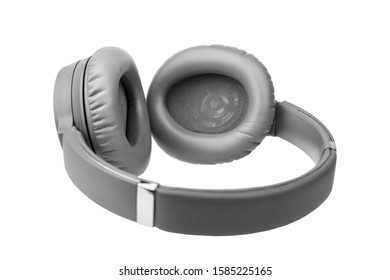 Gray wireless headphones on white background isolated close up, grey bluetooth headset with big leather ear pad cushions design, modern black wi-fi stereo sound earphones side view, audio music device