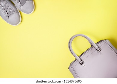 gray women bag and gray sneakers. view from above. copy space