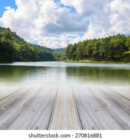 Gray wood floor perspective on the lake and forest backgrounds