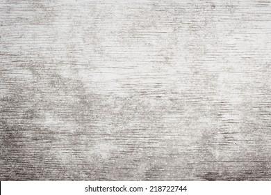 Grauer Holzhintergrund aus verwittertem, gestörtem rustikalem Holz mit abgeblasener weißer Farbe, Holzkornstruktur
