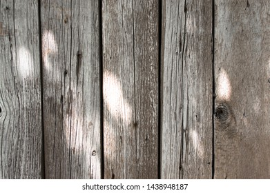 gray wooden boards sunspots fence background