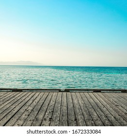gray wooden pier of free space for your decoration and landscape of ocean with blue sky
