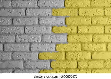 Gray and yellow brick wall background. Modern ideal interior design. Main color trend of the year 2021.