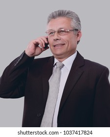Gray-haired business man smiling isolated on gray background.