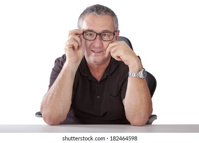 Gray-haired man with glasses sitting at desk