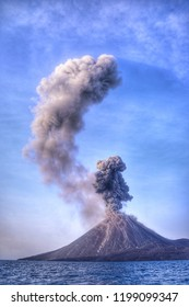 Grayish white smoke billowed out of the crater of Anak Krakatau mountain which is currently active