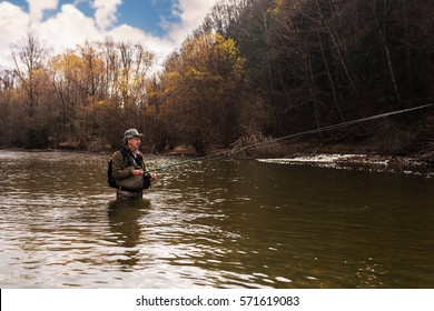 Grayling fishing on mountain river in the autumn