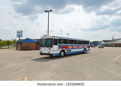 Grayling, Michigan, USA, August 13, 2018: Faith Baptist Church bus was parked in the square