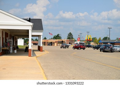 Grayling, Michigan, USA, August 13, 2018: shop area square with cars