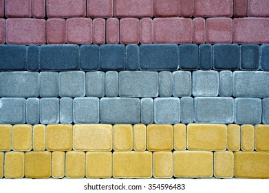 Gray-red-yellow paving slabs, background