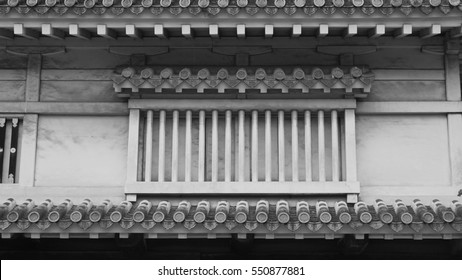 The grayscale (black and white) tone of historic house of Japanese Himeiji Castle, ancient and unique style of tiles and gable roof with batten stencil windows of the building, made by stone and wood