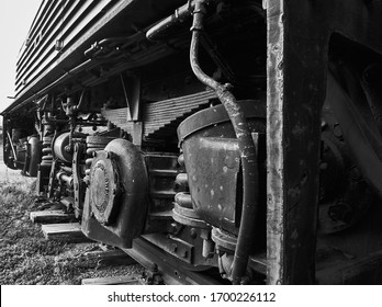 A grayscale shot of an old train