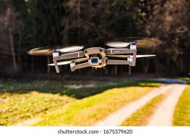 Graz, Austria 15.03.2020 - DJI Drone Mavic 2 Pro with Hasselblad camera flying in rural area. Copy space