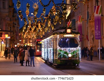 GRAZ, AUSTRIA - DECEMBER 11, 2017: A decorated street car runs through the Weihnachtsmarkt of Graz, Austria