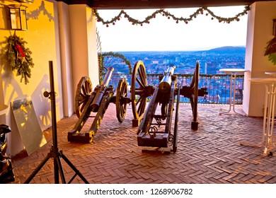 Graz, Austria - December 19, 2017 - Iron cannons above Graz at sunset view, Styria region of Austria. Schlossberg hill  is famous Graz viewpoint.