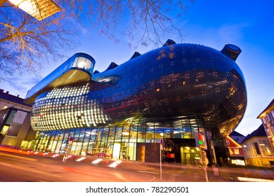 Graz, Austria - December 19, 2017 - The Kunsthaus Graz evening view, Styria region of Austria. Graz museum of Art is famous modern landmark built as part of the European Capital of Culture celebration