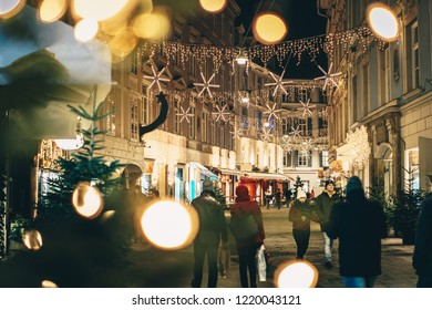 Graz, Austria - December 2017: Graz city streets advent Christmas decorations by night. Shot between Christmas lights.
